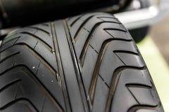 Foto nova do close up do pneumático do carro Fotografia de Stock