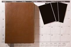 Foto på en kontorskalender royaltyfri foto