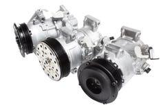 Foto på sammansättningen av de tre delarna för motorn Generator, betingande kompressor för luft och startknappen på en grå färg t arkivfoto