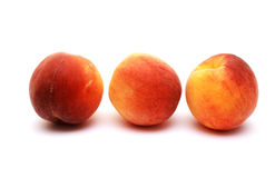 Foto of peaches placed on white background Royalty Free Stock Images