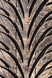 Foto preta usada muito velha do macro do pneumático Imagens de Stock