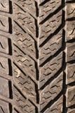 Foto preta usada muito velha do macro do pneumático Fotografia de Stock