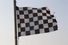 Foto a quadretti del cielo blu e della bandiera Immagini Stock