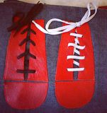 Abstract red shoes. Photo of a red shoes made of leather on a blue fabric Stock Photos