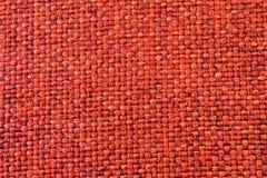 Foto rossa del primo piano di struttura del tessuto Immagine Stock