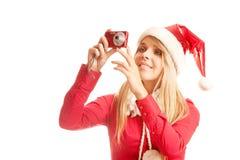 Foto's aan jonge santavrouw in Kerstmisvakantie Stock Foto