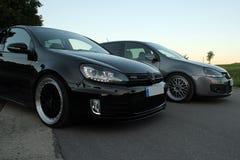 Foto` s av en Volkswagen Golf 5 och Volkswagen Golf 6 GTI Arkivbilder