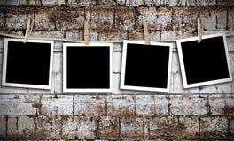 Foto's op een waslijn Stock Afbeelding