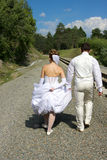 After foto session. Bride and groom walking around Novosibirsk, Siberia Royalty Free Stock Photo