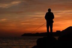 Foto simple de la aún-vida del pescador en la puesta del sol de la tarde Imagen de archivo libre de regalías