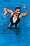 Foto sincronizada do Pose da dança da menina da nadada Foto de Stock