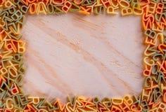 Foto som skapas från pasta i form av en bokstav - pasta, för inskrift royaltyfria bilder