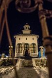 Orthodox Church in snow at night royalty free stock images
