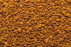 Foto van close-uptextuur van bruine gemalen onmiddellijke koffie, achtergrond royalty-vrije stock afbeeldingen