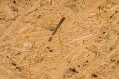 Foto van de textuur van de browndspaanplaat in dichte mening stock foto