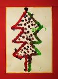 Foto van een daadwerkelijke die Kerstmisboom door een kind wordt voorbereid en wordt geschilderd royalty-vrije stock foto's