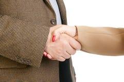 Foto van handdruk van partners na het slaan van overeenkomst Stock Fotografie
