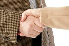 Foto van handdruk van partners na het slaan van overeenkomst Stock Foto's