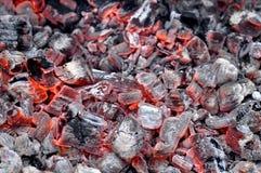 Foto van Heet Vonkend Live Coals Burning stock afbeeldingen