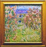 Foto van het originele het schilderen ` Huis onder de rozen ` door Claude Monet Stock Fotografie