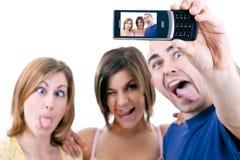 Foto van mensen die dwaze gezichten maken royalty-vrije stock foto's