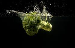 Foto von Gemüse fallen gelassen unter Wasser Lizenzfreies Stockfoto