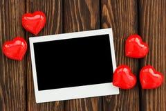 Foto y corazones rojos fotografía de archivo libre de regalías