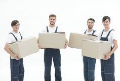Fotoarbetare som rymmer askar, när flyttande lägenheter, Arkivbilder