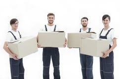 Fotoarbetare som rymmer askar, när flyttande lägenheter, Royaltyfri Fotografi
