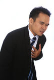 Fotobeeld van een knappe aantrekkelijke jonge Aziatische Zakenman die zijn hart in pijn houden Royalty-vrije Stock Afbeelding