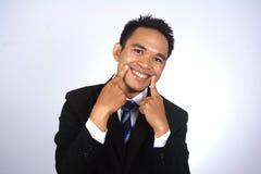 Fotobeeld van jonge Aziatische zakenman met grappige glimlach Stock Afbeelding