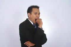 Fotobild av en stilig attraktiv ung asiatisk affärsman som gäspar gest Arkivfoto