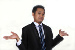 Fotobilden av en stilig attraktiv ung asiatisk affärsman med I-universitetslärare` t vet gest fotografering för bildbyråer