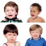 Fotocollage av criyng för fyra barn royaltyfria bilder