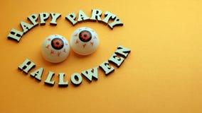 Fotoet för helloween partiet på den gula bakgrunden arkivbilder