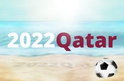 Fotoet 2022 för strandQatar fotboll och 3D framför bakgrund Arkivbilder