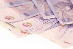 Fotoet spridde räkningar av ukrainsk valuta royaltyfria foton