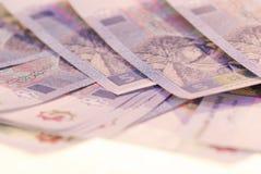 Fotoet spridde räkningar av ukrainsk valuta arkivbild