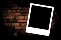 Fotofelder auf Backsteinmauer Lizenzfreies Stockbild