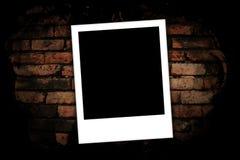 Fotofelder auf Backsteinmauer Stockfotografie