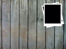 Fotofelder auf hölzernem Hintergrund Stockbilder