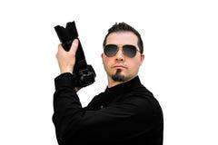 Fotograaf als Speciale Agent op witte achtergrond stock fotografie