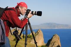 Fotograaf, driepoot, overzees, rotsen Stock Afbeeldingen