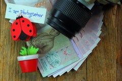 Fotograaf, inkomen, het inkomen van de fotograaf Stock Afbeeldingen