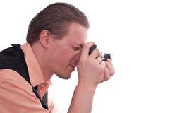 Fotograaf met camera in zijn handen stock foto