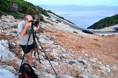 Fotograaf met een driepoot Stock Afbeeldingen