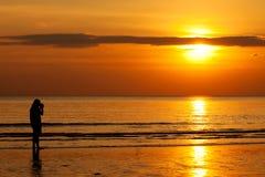 Fotograaf over de zonsondergang Stock Foto's