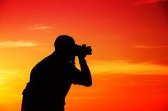 Fotograaf in zonsondergang Royalty-vrije Stock Afbeelding