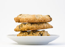 Fotografía del primer de las galletas de harina de avena en el pl blanco Foto de archivo