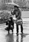 Fotografía en la lluvia Imagen de archivo libre de regalías